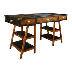 """Black Navigator's Desk - The Black Navigator's Desk measures 55.25""""L x 27.5""""W x 30.75""""H. Travelers and seafarers of yore had to be resourceful in order to survive. Desks on board ships had to be cleared and stowed at a moment's notice. Things had to be multi-functional. In the case of our desk, the two supports could act as steps into the navigator's bunk, or to mount to a camel, whichever came first. The desktop, complete with drawers and brass bound, could act to stop musket bullets when under fire. Leather top, hand rubbed French finish, somewhat beat-up; proof of its many voyages and colorful history."""