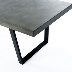 """The 'Taper Table' concrete and steel dining table - Cast concrete dining table.  Legs are 1"""" x 3"""" steel tube welded with a 7 degree taper.  The concrete top is cast with this same angle, creating a subtle octagonal shape.  The 3"""" thick concrete sides are also tapered to continue the angle to the base. This version is 7' x 3', and seats 6-8 people, but is can be created in any size."""