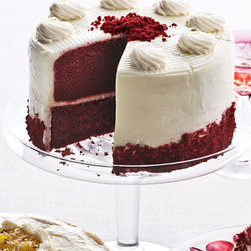 """ANNIE PIE'S BAKERY - Red Velvet Cake - ANNIE PIE'S BAKERYRed Velvet CakeDetailsMoist red velvet cake with fresh cream-cheese frosting finished with cream-cheese rosettes and red-velvet crumbs.Arrives partially frozen; remove collar before thawing.Thaw overnight in refrigerator before serving.If quick thawing is required leave out at room temperature for 30-60 minutes.Keeps 3-5 days in refrigerator; up to six months frozen.7""""Dia. Serves 8.Perishable items are shipped to you directly from our vendors. Therefore if you need to cancel an order we must receive the cancellation at least four days prior to your requested delivery date."""