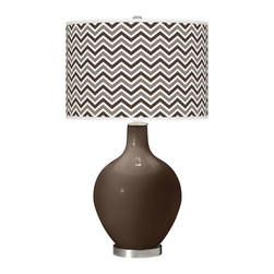 """Color Plus - Contemporary Carafe Narrow Zig Zag Ovo Table Lamp - Welcome exquisite color and design to your home decor with this Color + Plus™ glass table lamp. The design is hand-crafted by experienced artisans in our California workshops with a Carafe brown designer high-gloss finish. It is topped with a stylish custom made-to-order translucent drum shade that features a Narrow Zig Zag pattern in rich color tones that complement the base hue. Brushed steel finish accents balance the look in contemporary style. U. S. Patent # 7347593. Carafe brown designer glass table lamp. Narrow Zig Zag pattern giclee-printed shade. Custom made-to-order translucent drum shade. Brushed steel finish accents. Takes one maximum 150 watt or equivalent bulb (not included). 28 1/2"""" high. Shade is 15 1/2"""" wide 11"""" high. Base is 6"""" wide.   Carafe brown designer glass table lamp.  Narrow Zig Zag pattern giclee-printed shade.  Custom made-to-order translucent drum shade.  Brushed steel finish accents.  Takes one maximum 150 watt or equivalent bulb (not included).  28 1/2"""" high.   Shade is 15 1/2"""" wide 11"""" high.   Base is 6"""" wide."""
