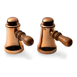 Copper Finish Salt and Pepper Shakers - Colored with a rich heirloom metallic to convey authenticity and warmth on your table, the Copper Finish Salt and Pepper Shakers have wood handles that coordinate with farmhouse tables and general good cheer. Between the polished glow of the tapering bodies and the practicality of the design, their impression of welcome and bonhomie is instantaneous.