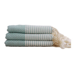 Fouta Hand Towels - Just like the fouta towels found at traditional Turkish baths, these hand towels are hand-loomed and made with pure cotton that gets softer with each use. Featuring impeccable details and exotic colors, they add an original and alluring accent to the bathroom or the kitchen. They also make for a great hostess gift. Made in Tunisia. Sold individually or as a set of three.