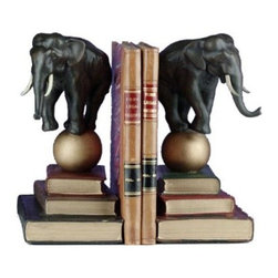 Elephant on Ball Bookends - Uniquely display your books in the Elephant on Ball Bookends. Created in polyresin and finished in gold and bronze this unusual pair of bookends features an elephant balancing on a ball and stack of books. The Elephant on Ball Bookends are sure to make you and your family want to head out to the circus! Made in the USA. Dimensions: 8.25L x 5W x 11H inches.