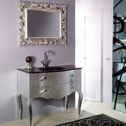 Iotti - 39 Inch Bathroom Vanity Set - Baroque styling and 21st Century convenience combine in this vanity set from Italy. The striking Silver finished cabinet and matching mirror frame have solid, waterproof construction underneath for long life. E1 Ecological panels mean ultra low emissions of harmful pollutants like formaldehyde. Comes with a fitted black glass sink and two soft close system drawers for easy access and longer life. The framed, five layer mirror resists scratches and corrosion. Set Includes: . Vanity Cabinet with sink (2 drawers). Mirror (37 inch x 29.5 inch ). Vanity Set Features:. Vanity cabinet made of engineered wood with glass sink. Cabinet features waterproof panels. Available in Silver. Cabinet features 2 soft-closing drawers. Faucet not included. Perfect for modern bathrooms. Made and designed in Italy. Includes manufacturer 5 year warranty.