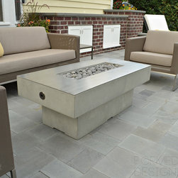 Wilmette Outdoor Concrete Fire Table - Chicago, IL - Custom concrete fire table with stainless steel overlay, decorative rolled lava stone burner topping.