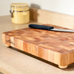 Catskill - 17 x 13 Professional End Grain Cutting Board with Feet Multicolor - 1814 - Shop for Cutting Boards from Hayneedle.com! A must-have for anyone who spends a lot of time cooking the Professional End-Grain Cutting Board with Feet 17 x 13 is a smart and functional accessory to the kitchen. The assembly of the end-grain wood creates a stunning patchwork effect that is as beautiful as it is durable. Wooden feet feature non-slip rubber pads to keep the board in place as you chop slice and pound. You'll appreciate the finger slots on each end that make for easy handling. This item is made from oil-finished natural yellow birch hardwood which is indigenous to the Northeastern U.S. and ranges in color from blond to a darker walnut shade; the natural variation in color allows this board to coordinate with your existing decor. Catskill Craftsmen's Eco-friendly PracticesCatskill Craftsmen is committed to protecting the environment through responsible forest management and manufacturing practices. Located in the Catskill Mountains of upper state New York Catskill Craftsmen plays a role in maintaining the health of the New York City watershed. This watershed provides clean water for New York City and other communities in the area. Healthy well-managed forests are better able to filter pollutants from entering streams and rivers which preserves the quality of watershed resources. With this goal in mind the company supports the efforts of the Watershed Agricultural Council (WAC). With the WAC Catskill Craftsmen encourages lumber suppliers (family forest owners and public land managers) to make wise harvesting decisions and control erosion in order to safeguard water quality. Other efforts to protect the environment include using sustainable wood sources and reducing wood waste. Catskill Craftsmen's manufactured items are made from naturally self-sustaining non-endangered North American hardwoods primarily birch and hard rock maple. All sawdust shavings and waste materials generated during the manufacturing process are converted into wood pellet fuel used to heat homes. This alternative heating source creates less ash and lower emissions than some other fuels. By operating their own wood pellet mill Catskill Craftsmen reduces their wood waste to zero. As natural resources become even more valuable Catskill Craftsmen will continue to advance proper stewardship of the pristine Catskill Mountain region. About Catskill CraftsmenFor over 60 years Catskill Craftsmen has provided customers with high-quality domestic hardwood ready-to-assemble products. Located in Stamford New York Catskill Craftsmen manufactures kitchen carts islands work centers gourmet butcher block chopping blocks cutting boards hardwood cabinets furniture book carts and racks. Catskill Craftsmen is recognized as the nation's leading manufacturer of premium wooden products.