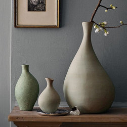 New Discord Vases - Go with the flow. These abstract free-flowing forms—in matte, subtly textural green glazes—look natural grouped together on windowsills, tabletops and bookshelves, whether filled with flowers or without.