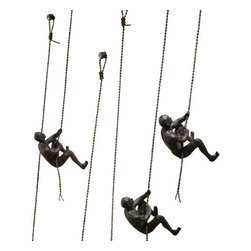 Climbing Man Wall Sculpture - As you sit in your living room relaxing, you admire the Climbing Man Wall Sculpture. Their burnished metal detailing, included hardware, and easy installation bring a smile to your face. Whether you've installed a stand alone piece or a group, the 3D artwork you've hung in your home fit your personality perfectly. Each piece is crafted from environmentally-friendly materials and ships in recyclable packaging. We're proud of you for that.