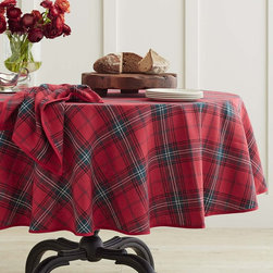 Classic Tartan Plaid Tablecloth - Can't you just see your holiday dishes paired with this Williams-Sonoma tablecloth? The great thing is that any white dishes you already have will instantly take on a festive look.