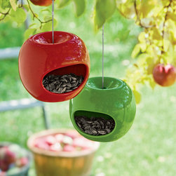 Apple Bird Feeders - Apple bird feeders — how cute! These bright feeders would look great in any tree and are a great addition to any feeding station. For those of us that don't have apple trees, we can now pretend.