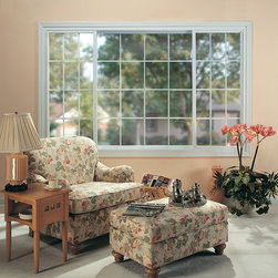 Sliding Window - Designed with a track and roller system that makes opening and closing easy, these windows perform just as good as they look. Available in two different picture configurations (1/4–1/2–1/4  or 1/3–1/3–1/3).
