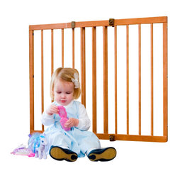"""Cardinal Gates - The Wood Gate from Cardinal - This beautiful wood gate in mahogany from Cardinal is not only easy on the eyes, it is highly durable and made to last for years. This gate fits spaces up to 49"""" in width without extensions. Additional features: Simple installation Works well with most standard baseboards Can be used in angled opening spaces of up to 30 degrees. Kid-safe latch that keeps toddlers from opening but doesn't stop adults One way swing construction Made from gorgeous real wood materials Post attachment kit is available separately. Dimensions 29.5"""" high / 30.5"""" installed Very flexible with adjustable widths from 29.5"""" to 49.25"""" 2.25"""" between rungs"""