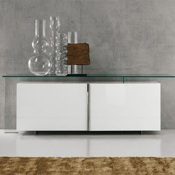 Cattelan Italia - Cattelan Italia | Avenue Credenza - Made in Italy by Cattelan Italia.Simple elegance and masterful craftsmanship is at the heart of the Avenue Credenza. Crafted from lacquered wood with a glass top that floats above its base, it adorns any room with ease and grace. Its two spacious sliding doors help store and display all your accessories with beauty. Within the interior of the unit are clear glass shelves making it ideal for the home and office alike.