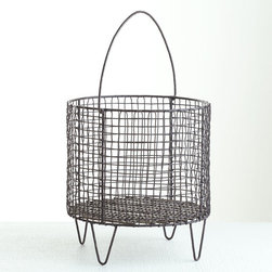 Iron Mesh Basket - Large - Iron wire and a woven design make this one of the strongest baskets you'll ever own. Though ideal for storing logs by the hearth, it would also work well as a planter or a storage solution for any room or purpose. It has a built-in iron handle for easy mobility and three sleek, sturdy legs.