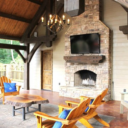 Pool House with a Fireplace - A beautiful handcrafted timber frame pool house along with an outdoor fireplace to warm up the evenings.