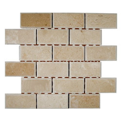 "Crema Marfil 2x4 Beveled Stone Tile - CREMA MARFIL 2X4 BEVELED MARBLE TILE This creama marfil beveled tile can make any room look contemporary to classic. The mesh backing not only simplifies instalaltion, it also allows the tiles to be separated which adds to their design flexibility. Chip Size: 2x4 Beveled Edge Brick Color: Crema Marfil Material: Marble Finish: Polish Sold by the Sheet - each sheet measures 12"" x 12"" (1 sq. ft.) Thickness: 8mm"