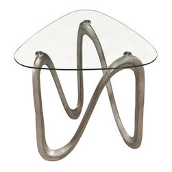 Magnussen Spano Shaped End Table - Modern art that's functional, too, the Magnussen Spano Shaped End Table is an ideal chair side addition. This end table features a shaped metal base with a contemporary brushed pewter finish. Its triangular, clear glass top has rounded edges for safety and visual drama.About Magnussen FurnitureFrom its beginning as a small furniture company in Ontario, Canada, Magnussen Furniture has evolved into a full-line furniture resource with offices in Canada, the United States, and the Far East. Their business is creating furniture designs of exceptional style, value, and beauty. They produce these designs in partnership with manufacturing partners around the world that meet exacting standards for superior quality at the best possible value.