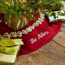 Crewel Embroidered Tree Skirt - It would be fun to have a tree skirt with the family name embroidered on it.