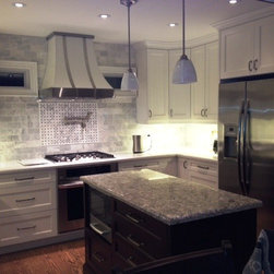 Custom Range Hoods - Range hood in gardenia white with brushed stainless steel accents