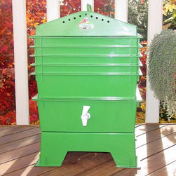 "VermiHut - VermiHut 5-Tray Recycled Plastic Worm Composter - Green - G900203-G - Shop for Garden Equipment from Hayneedle.com! Product upgrade! This worm composter now features an organic compostable coconut fiber mat. This mat absorbs moisture and minimizes fruit flies. Use green be green. Put 6000 volunteers to work for you for free. The VermiHut 5-Tray Recycled Plastic Worm Composter - Green is worm heaven and they'll cheerfully go to work composting the kitchen waste you used to throw away. This odorless compact system is fast and efficient: start worms on the bottom shelf and they migrate up as they finish leaving behind the richest black dirt you've ever seen. Just pull out the bottom tray refill it with scraps and put it back on top. The included simple instructions are for you; the worms already know what to do. This 5-tray composter is made of green high-density polyethylene durable and odor-proof. Worms aren't included but you can order them at checkout. We recommend starting with 1000 worms. Their numbers will grow fast because they're wallowing in the lap of worm luxury if worms had laps. Expect a colony of 6000 worms all working for you. How does it work?It's easy. Fill each tray with scraps: vegetables fruits egg shells coffee grounds and paper (yep junk mail is worm candy). Your worms will dig in happily silently odorlessly leaving behind the very best compost available for free. Your plants will go nuts. You don't have to sift through the wiggly workers because they've already moved up to the next tray. Super nutrient-rich moisture is captured in the drip tray the famous liquid fertilizer known by fans as ""worm tea."" Benefits of the VermiHut Worm ComposterOdorless: Breathe easy. Follow the easy instructions included and this natural process breaks down smelly garbage into rich black dirt fresh as a spring day.Compact: The trays stack taking up little space. No big tumbler no shoveling.Easy: No more running out to your composter to mix it up every week! The worms do the work for you recycling up to 8 pounds of food per week. They don't take nights off so you get compost faster a whole tray of nutrient-rich castings every month."