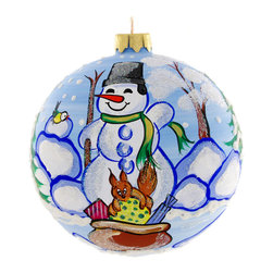 """""""Christmas Gifts"""" Hand Painted Christmas Ball. Made in Ukraine - """"Christmas Gifts"""" hand painted  glass Christmas ball ornament is 4"""" (100 mm) in diameter and made of hand blown glass by skillful artists in Ukraine. On this ornament a snowman and animals got a surprise from Santa - a huge bag of gifts. No wonder the snowman is very happy! Fully hand painted. No two look alike ornaments and slight variations might occur."""
