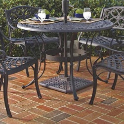 HomeStyles - 5-Pc Outdoor Dining Set (42 in. - Black) - Finish: 42 in. - BlackIncludes dining table and four arm chairs. Umbrella stand not included. Patterned round table top. Center opening to accommodate umbrellas. Nylon glides on all legs. Hand antiqued powder coat finish sealed with a clear coat to protect finish. Stainless steel hardware. Made from cast aluminum. Seat height: 15.5 in.. Arm height: 24.75 in.. Chair: 22.83 in. W x 21.65 in. D x 32.68 in. H. Table: 42 in. Dia. x 29 in. H. Warranty. Table Assembly InstructionsWith its intricately designed metal work, our outdoor dining table set will certainly become the focal point of the deck or patio! Need an added incentive? It's maintenance free!