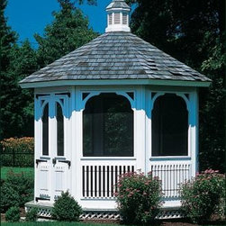 Victorian Garden House Gazebo - This single tiered Victorian garden house features window screen inserts and screened front door. Pictured with optional white stain. Shipped kit. Motor freight.
