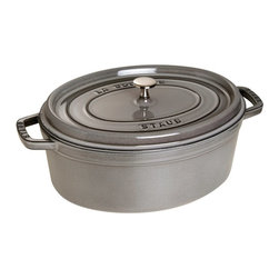 Staub - Staub Oval Cocotte - 7 qt. - Graphite Gray Multicolor - 1103318 - Shop for Baking & Roasting Dishes from Hayneedle.com! Prepare meals like a pro with the Staub Oval Cocotte - 7 qt. - Graphite Gray. This industrious pan ensures every dish you make will be flavorful. The extra-heavy lid seals in moisture and dozens of well-placed spikes continuously baste the food below ensuring your dish retains the full flavor of each ingredient. When it's time for clean up simply pop this pan into the dishwasher. The high-quality enamel coating resists scratches and will never discolor.About Staub CookwareFrom professional chefs to home cooks people with a passion for cooking rely on Staub cookware. Combining the utility of cast iron with the latest technology available Francis Staub designed his first enameled pot in 1974 in the Alsace region of France. Known for performance style and durability Staub has become the benchmark for enameled cast-iron cookware. Ideal for braising searing roasting and caramelizing food Staub's signature pots - called cocottes - feature an enameled interior with a matte black finish. Resistant to rust chipping and cracking cocottes are available in round and oval shapes in a variety of sizes and colors. Just right for slow-cooking food Staub cocottes are designed to provide even heat distribution excellent heat retention and continuous self-basting. The inside of each heavy snug-fitting lid features a series of bumps (or self-basting spikes) to allow continuous natural basting by distributing moisture throughout for extra flavor and tenderness. In addition to its signature cookware which is perfect for serving at the table Staub also offers pans for frying sauteing grilling and roasting as well as a variety of teapots accessories and gourmet specialty items.