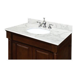 Sagehill Designs 25W x 22D in. Carrara Marble Vanity Top with Undermount Sink - The Sagehill Designs 25W x 22D in. Carrara Marble Vanity Top with Undermount Sink outfits your 24-inch wide vanity countertop with a handsome cap-piece that complements any traditional-style bathroom perfectly. The counter-top is made with genuine .75inch-thick white Carrera marble that's as solid as it is beautiful. A oval undermount sink comes pre-mounted to the counter made from fine white porcelain and featuring a 7.25-inch depth. The marble comes pre-polished and coated with a protective sealant for superior damage control and headache-free maintenance. The unit comes drilled with three holes that fits any standard 8-inch widespread faucet set (not included). A matching four-inch high backsplash is included. A three-step installation design makes fitting the unit to your bathroom as easy as one-two-three. About Sagehill DesignsWith Sagehill Designs it's all in the details. Since 1986 Sagehill Designs has been crafting superior quality kitchen and bath furnishings. Rich in detail that matter you'll find heirloom-quality finishes impeccable craftsmanship and generous storage wrapped in a smart design. You get it all with a Sagehill Design original. Sagehill Design's specialists in helping you create the perfect kitchen or bath environment.