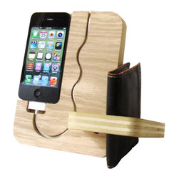 Undulating Contours - iPhone Docking Station - This iPhone 4, 4s, 5, dock is truly a stylish multitasker. It could be used on a nightstand as a charging station/valet or as a docking station and desk organizer at the office. The roomy side slot can store items such as posted notes at the office or a wallet at home. One of the best features of this docking station is that you have full access to all your phones buttons without having to remove it from the dock. A ton of storage can be found on the rear of the unit for pocket change, keys, or paperclips etc.