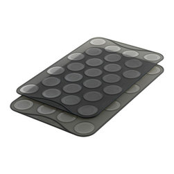 Mastrad Macaron Baking Sheet Set - The Mastrad macaron baking sheets set of 2 has 25 ridges on each sheet with precise filling marks that makes 1.5 inch perfectly sized pastry shells. The set of 2 allows you to fill one sheet while the other is baking. The flexible non-stick silicone sheet makes turning out easy and guarantees perfectly sized macarons every time and is also perfect for merinagues biscuits cookies. The sheet can be flipped over and used as a flat baking sheet too!