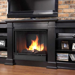"Real Flame - Fresno Ventless Gel Fireplace in Black - Uses clean burning Real Flame gel fuel emitting up to 9,000 BTUs of heat per hour lasting up to 3 hours.. Uses Only Real Flame 13oz Gel Fuel Cans, not included. Fireplace includes wooden mantel, firebox, hand painted cast-concrete log, and screen kit.. Fits up to a 50"" diagonal TV - 100lb. weight limit.. Solid wood and veneered MDF construction. Shelf dimensions: 17"" x 14.5"". 71.73 in. W x 19 in. D x 29.88 in. H (143.8 lbs.)Enjoy the crackle and ambiance of a Real Flame fireplace, this substantial freestanding fireplace also doubles as an entertainment center. This unit is able to hold a 50"" diagonal  television of 100 lbs. or less and has adjustable shelving, to accommodate most electronics. Uses 13 oz. cans of Real Flame Gel Fuel."