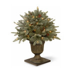 26 In. Feel Real Frosted Spruce Porch Christmas Bush w/ 50 Clr Lights - Measures 26 inches tall with 25 inch diameter. Indoor or covered outdoor use. Features FEEL-REAL branch tip technology for remarkable realism! Pre-lit with 50 UL listed, pre-strung Clear lights. Tip count: 225. Trimmed with pine cones. Light string features BULB-LOCK to keep bulbs from falling out. If one bulb burns out the others remain lit. Includes spare bulbs and fuses. Fire-resistant and non-allergenic. Packed in reusable storage carton.