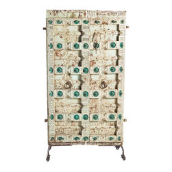 """Antique Dragonfly Door - The Antique Dragonfly door is truly a historic piece. Similar to many other doors in our shop, this piece was rescued from a decaying building in India and its beauty preserved. This is a rustic, white door hand-carved with dragonfly and teal floral accents for a one-of-a-kind, timely piece. Choose to have it installed as an entryway piece, a king-size headboard, or hang it as-is in a large space where it can captivate the attention of your guests.Comes with rolling stand.Dimensions: 4""""L x 44""""W x 71""""H"""