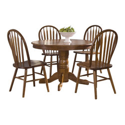 Liberty Furniture - Nostalgia 5 Pc Dining Set - Includes table and four side chairs. Empire single pedestal design. Arrow back. Saddle shaped seating. Nylon chair glides. Comfortably seats upto 4. Warranty: One year. Made from select hardwoods and oak veneers. Medium oak finish. Made in Malaysia. Table: 42 in. Dia. x 30 in. H (62 lbs.). Chair: 20 in. W x 19 in. D x 38 in. H (11 lbs.)