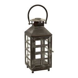 iMax - iMax Drake Small Candle Lantern X-62365 - This IMAX Drake small candle lantern takes decorating with style to the next level. This incredible, oriental-style piece, with the straight lines of the wrought iron frame that create small, square window panes and topped with a handle, will look good alone or when combined with the tall version. Once you place a lit pillar candle inside, it's sure to create a warm and inviting atmosphere.