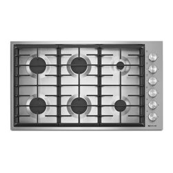 "Jenn-Air® 36"" 6-Burner Cooktop - Sleekly redesigned, the new gas cooktop features refined knobs, continuous grates and a profile that's flush to the countertop at just 3 millimeters high. It also offers impressive precision and powerful heat, with an 18,000 BTU burner that goes as low as 2,200 BTUs, and a simmer burner for an even more delicate flame."