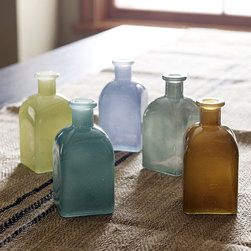 Recycled-Glass Bud Vases - Diminutive vessels in jewel tones host buds in a spectrum of sophisticated hues—making a bold impact when displayed en masse in multiple colors.
