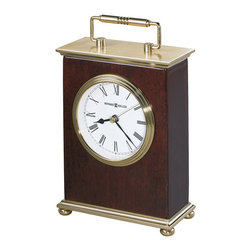 Howard Miller - Howard Miller Rosewood Bracket Tabletop Clock - Howard Miller - Mantel / Table Clocks - 613528 - This contemporary mantel clock reflects simple elegant style and is as well-suited to any shelf or desk/counter as it is to a mantel. Distinguished by its warm wood box frame, white dial with brass triple rim and bezel and decorative brass finished handle, the Rosewood has a casually refined character sure to be appreciated. Battery operated quartz movement and a rosewood hall finish round out the look and appeal of the Rosewood Bracket Tabletop Clock.
