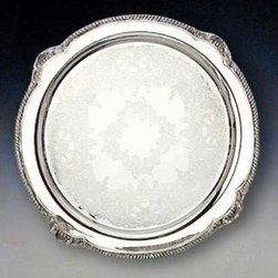 "Reed & Barton Round Serving Platter - Reed & Barton's story began in 1824 when Isaac Babbitt created a new metal alloy - ""Britannia metal"" - in his Taunton Massachusetts pewter shop. Babbitt joined forces with craftsmen Henry G. Reed and Charles E. Barton to produce this innovative higher-quality pewter ware. Reed & Barton offered to take control and began manufacturing products under their own names. The fledgling company's goods reflected uncompromising standards of excellence starting with its initial silver-plate products and extending to the exquisite sterling silver creations that resulted from the silver discoveries of the late 1800s.Today Reed & Barton is world-renowned for its vast array of high-quality sterling silver silver-plated and stainless flatware and giftware. The company's distinguished family of brands includes Reed & Barton Handcrafted Chests Miller Rogaska Crystal and R & B EveryDay. Reed & Barton is also the exclusive U.S. distributor of Belleek Fine Parian China and Aynsley Fine English Bone China Tableware. As one of the oldest privately held silversmith companies in the United States Reed & Barton remains steadfast in its commitment to fine design and superb craftsmanship."