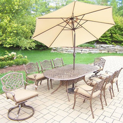 Oakland Living - 11-Pc Oval Outdoor Dining Set - Includes table and six dining chairs, two swivel chairs, 9 ft. tilt crank umbrella with stand and metal hardware. Handcast. Umbrella hole table top. Fade, chip and crack resistant. Traditional lattice pattern and scroll work. Hardened powder coat. Rust free. Warranty: One year limited. Made from cast aluminum. Antique bronze finish. Minimal assembly required. Table: 84 in. L x 42 in. W x 29 in. H (99 lbs.). Chair: 21.5 in. W x 23 in. D x 34 in. H (27 lbs.)The Oakland Mississippi Collection combines southern style and modern designs giving you a rich addition to any outdoor setting. This dining set is the prefect piece for any outdoor dinner setting. Just the right size for any backyard or patio.