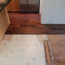 Residential remodel - Los Angeles - Long plank solid custom walnut is going in...