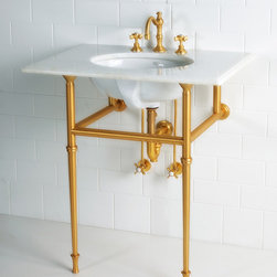 Featured Vendor - Watermark Designs - A traditional console with tapered legs shown in Satin 24k gold finish.