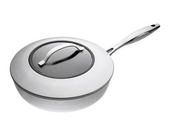 """Scanpan CTX 11 Inch Covered Saute Pan - This beautifully designed Scanpan CTX 11"""" saute pan is a large straight sided pan made to cook for a group of 2-3 people. Its stainless steel handle does not get hot and provides a secure grip and the pan is ovenproof up to 500° F (260°C). Featuring a strong design and durable materials Scanpan CTX is an exclusive series of pots and pans for the everyday demands of food enthusiasts. With CTX you get uncompromising cookware in the best Danish quality. The ceramic titanium surface is extraordinarily robust and safe for use with metal and steel kitchen tools. The durable non-stick coating ensuring perfect cooking and the brushed steel exterior makes CTX look great on every stove. PFOA & PFOS free. Suitable for use on all cooktops including induction."""