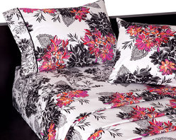 koi Design - Serpentine Sheet Set - Give your bedding the ultimate upgrade with a swirling dose of foliage and blooms. This cotton sheet set displays a lavish mix of black and white with an artful hit of hot pink and orange that's sure to please the lady or young lady of the house. Colorful accent pillows welcome!