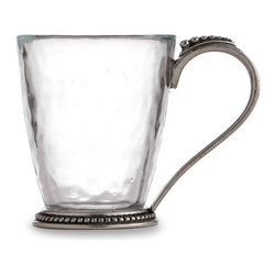Tesoro Mug - Create a suave and vivacious European look on your breakfast table or serve coffee after a bakery dessert in high style. The Tesoro Mug, made from softly wavering glass in an updated taper form, presents intriguing yet traditional beaded designs on its beautifully-cast pewter foot and handle. These stately details add understated romance to a simple cup of coffee.