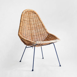 Midcentury Basket Chair by Hindsvik - Wicker and rattan just seem like natural beach house options. They are easy to clean, can move indoors or out and can withstand someone sitting on them with a wet bathing suit. I'd go for midcentury vintage every time to pull off the right look.