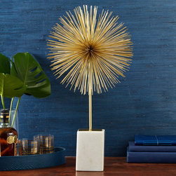 "Two's Company - Starburst Statue - The Starburst statue boasts a retro style, updated with modern glamour. A cluster of thin golden rods creates a vibrant decorative explosion, mounted on white marble. 12""W x 22""H; Iron and marble; Brass finish"