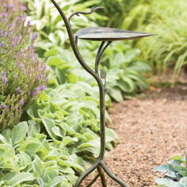 Bronzed Leaf Birdbath - This organic birdbath seems delicate but is sturdy. It's small enough to fit in large containers on your patio or deck but interesting enough to be a focal point in your garden.