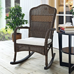 Coral Coast - Coral Coast Mocha Resin Wicker Rocking Chair with Beige Cushion Multicolor - CW4 - Shop for Chairs and Sofas from Hayneedle.com! Sophisticated elegance meets classic beauty with the Coral Coast Mocha Resin Wicker Rocking Chair with Beige Cushion. This rocking chair is crafted from beautiful resin wicker which has all the intricate detail of traditional wicker along with added durability and strength. Resin wicker is made to withstand UV rays and is water resistant it also doesn't fade over time making it a great choice for indoor or outdoor use. You'll fall in love with its classic look and feel as well as its rich mocha finish and luxurious comfortable beige cushion. Gentle sloping arms and a mixed weave back add an elegant touch to this rocking chair. Easy to clean with mild soap and water this rocking chair is a gorgeous addition to any home. Additional Features All-weather resin wicker is made to last UV- and water-resistant Does not fade over time Easy to clean and maintain About Coral CoastWhat if when you closed your eyes you pictured yourself in your own backyard? Coral Coast has a collection of easygoing affordable outdoor accessories for your patio pool or backyard. The latest colors and styles mingle with true classics in weather-worthy fabrics and finished woods ready for relaxation. Make yours a life of leisure.